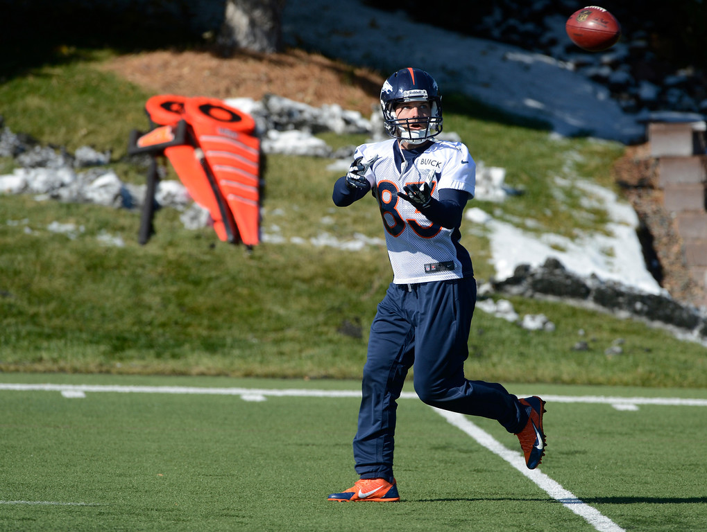 . Denver Broncos WR, Wes Welker,  catches a pass during practice Friday morning, October 18, 2103.  (Photo By Andy Cross/The Denver Post)