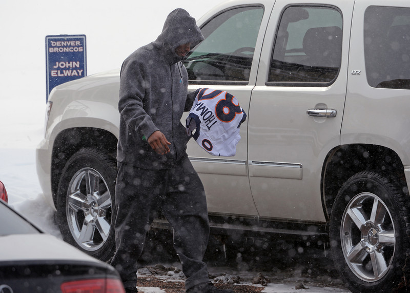 . Denver Broncos safety Rahim Moore leaves with a jersey from tight end Julius Thomas as he and other players leave Dove Valley for the season  in Englewood, Co on February 4, 2014. (Photo By Helen H. Richardson/ The Denver Post)