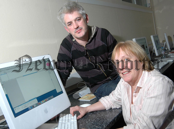 Gretta Jackson from Newry, looks at her new web design with Digital Diversity tutor Ciaran Maher at the Upper Bann Institute, Banbridge. (UBI-Dundalk-4)