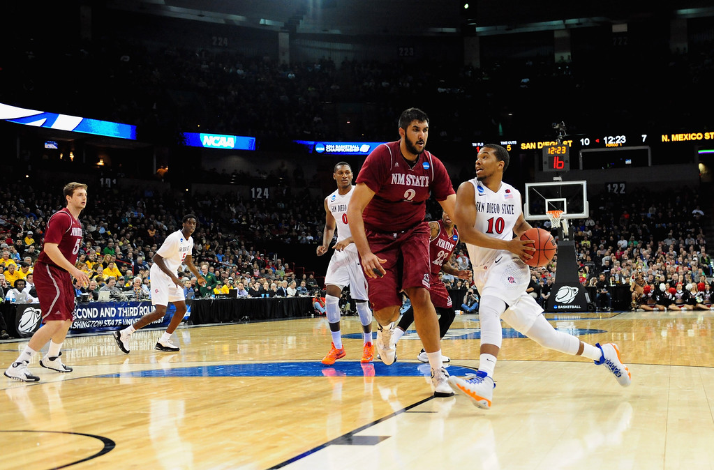 . SPOKANE, WA - MARCH 20:  Aqeel Quinn #10 of the San Diego State Aztecs drives the ball past Sim Bhullar #2 of the New Mexico State Aggies during the second round of the 2014 NCAA Men\'s Basketball Tournament at Spokane Veterans Memorial Arena on March 20, 2014 in Spokane, Washington.  (Photo by Steve Dykes/Getty Images)