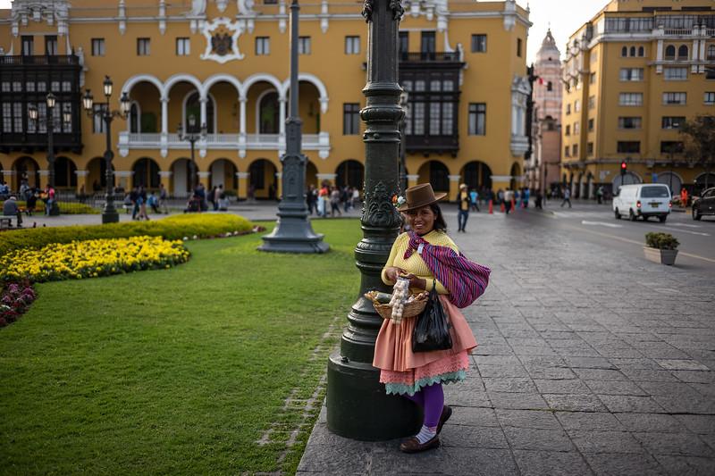 woman selling sweets Plaza Mayor Lima.jpg