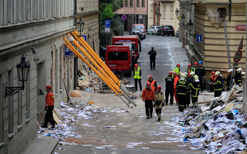 . Rescue workers inspect a scene of a gas explosion in downtown Prague, Czech Republic, Monday, April 29, 2013. A powerful explosion badly damaged an office building in the center of the Czech capital Monday, injuring up to 35 people. (AP Photo/Petr David Josek)