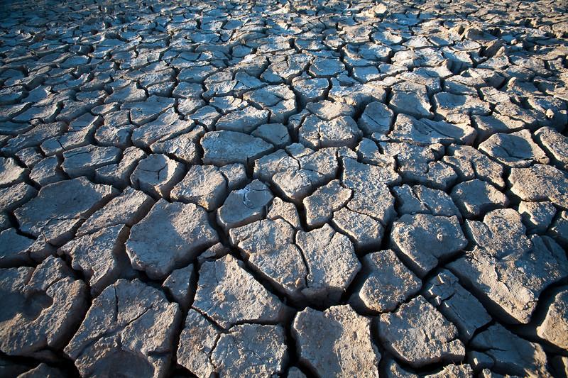 Cracked soil on a dried marshland. Town of Sanlucar de Barrameda, province of Cadiz, Andalusia, Spain.