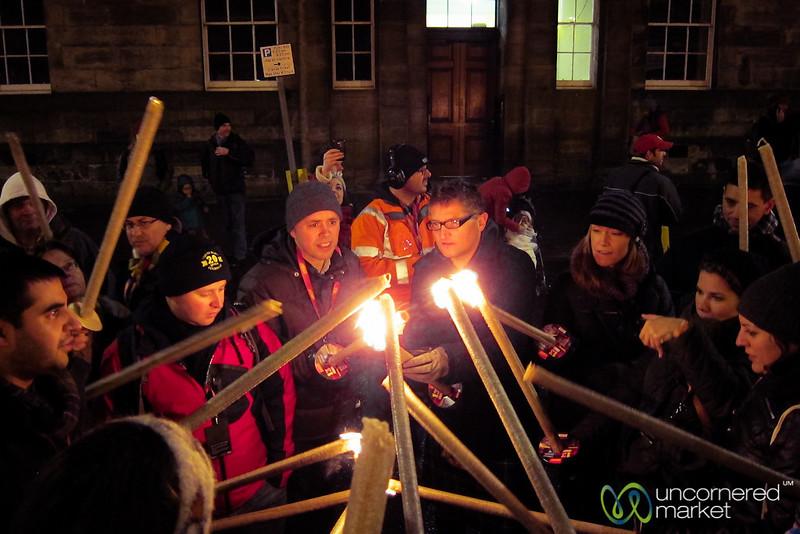 Sharing Fire at Edinburgh's Torchlight Procession