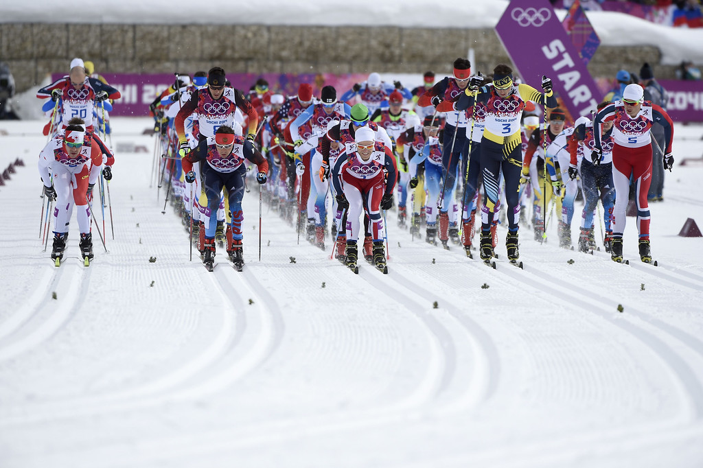 . Athletes ready at the start in the Men\'s Cross-Country Skiing 15km + 15km Skiathlon at the Laura Cross-Country Ski and Biathlon Center during the Sochi Winter Olympics on February 9, 2014, in Rosa Khutor. ODD ANDERSEN/AFP/Getty Images