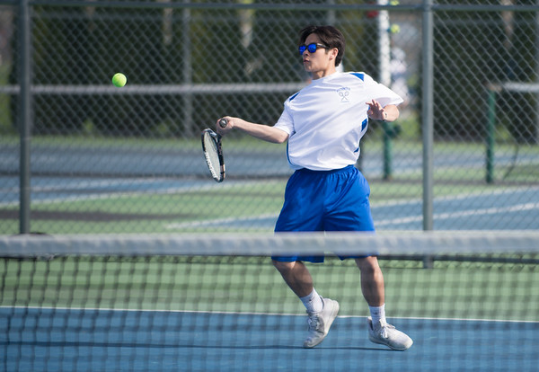 04/17/19 Wesley Bunnell | Staff Southington boys tennis hosted Berlin on Wednesday afternoon at Southington High School. Southington's Michael Kwok.