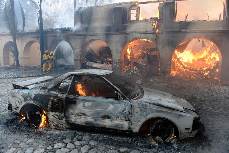 . A car and house burn in The Colby Fire above Glendora, Calif., Thursday Jan. 16, 2014. Nearly 2,000 residents were evacuated and two homes burned in a wildfire that started early Thursday when three people tossed paper into a campfire in the dangerously dry foothills of Southern California\'s San Gabriel Mountains, authorities said. (AP Photo/Inland Valley Daily Bulletin, Will Lester)