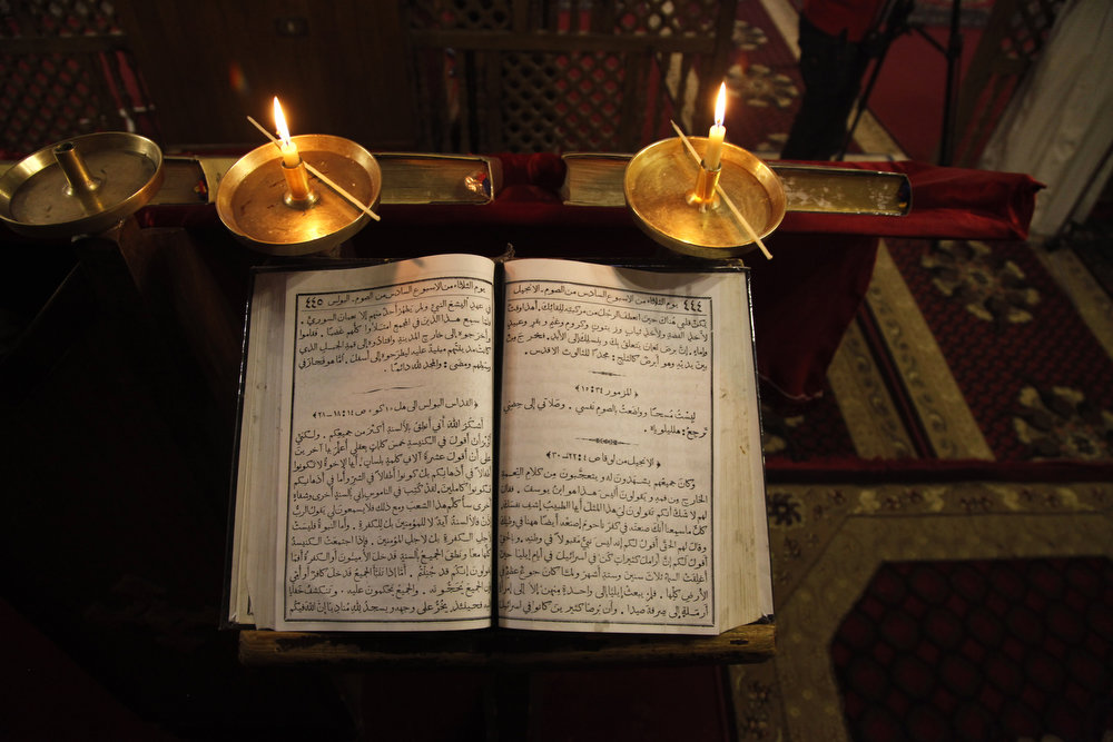 . A Bible, printed in Arabic, at the ancient monastery of St. Anthony in the eastern desert southeast of Cairo, Egypt on Tuesday, April 16, 2013. In a cave high in the desert mountains of eastern Egypt, the man said to be the father of monasticism took refuge from the temptations of the world some 17 centuries ago. The monks at the St. Anthony\'s Monastery bearing his name continue the ascetic tradition. But even they are not untouched by the turbulent times facing Egypt\'s Christians, defiantly vowing their community\'s voice won\'t be silenced amid Islamists\' rising power.   (AP Photo/Manoocher Deghati)