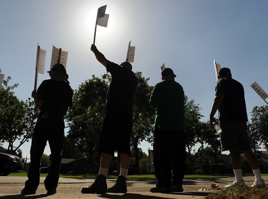 . Employees with the Upland Unified School District protest outside the office on Euclid Avenue Tuesday June 18, 2013. They are protesting against possible higher health care costs due to a budget short fall.  (Staff photo/Inland Valley Daily Bulletin)