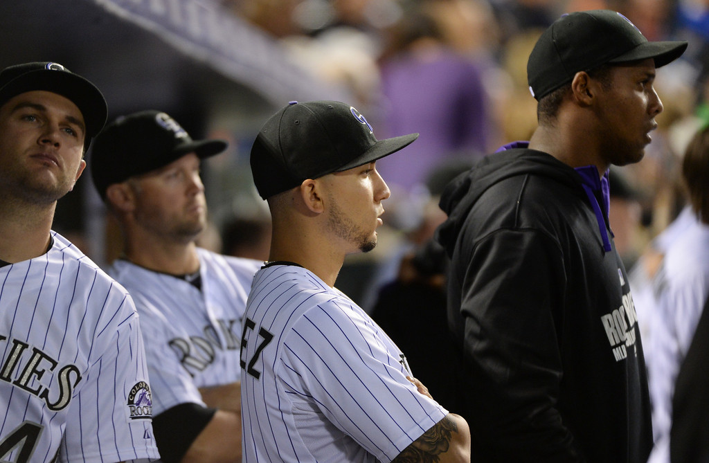 . DENVER JUNE 06: Carlos Gonzalez of Colorado Rockies (5) is watching the game against Los Angeles Dodgers from the dugout at Coors Field in Denver, Colorado June 6, 2014. (Photo by Hyoung Chang/The Denver Post)
