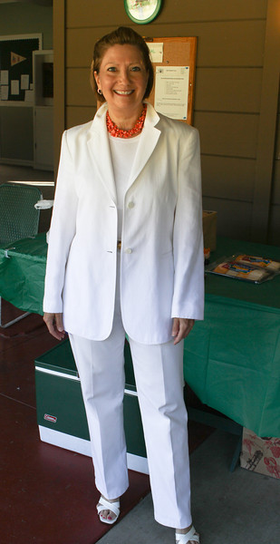 Event Co-Chairperson, Janet Kluczynski '77, models her whites.