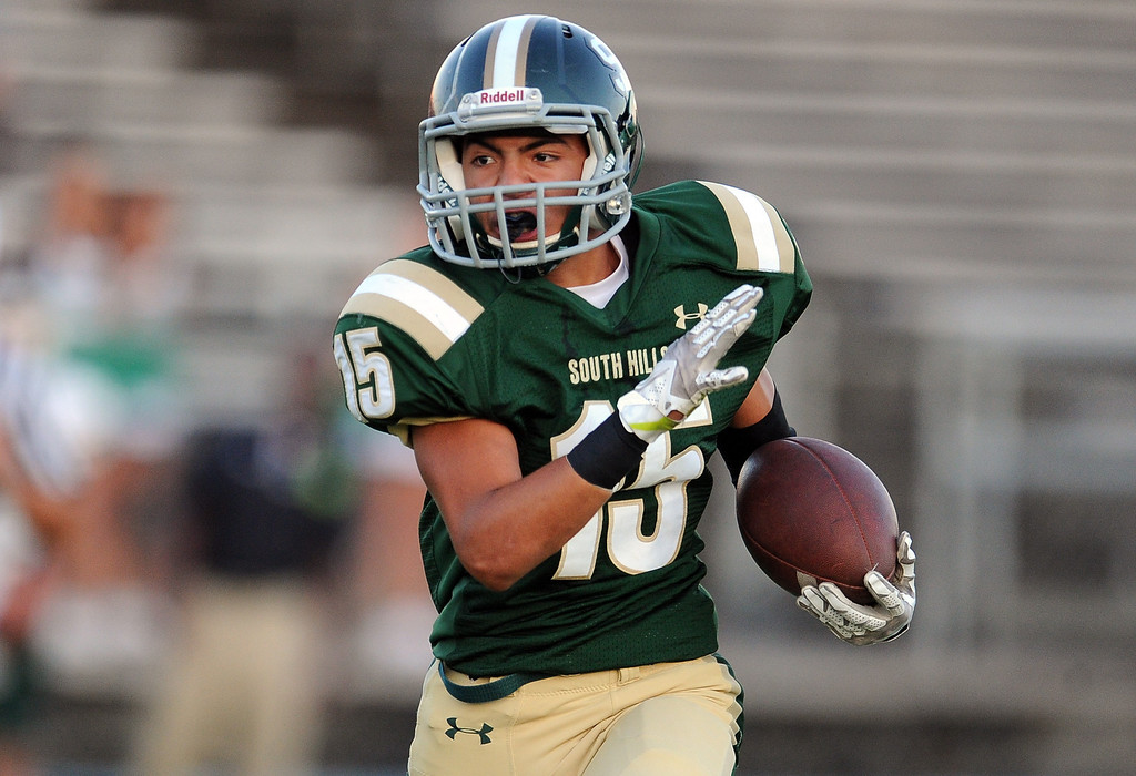 . South Hills\' Carlos Delgado runs for a first down against Bonita in the first half of a prep football game at Covina District Field in Covina, Calif. on Friday, Sept. 6, 2013.   (Photo by Keith Birmingham/Pasadena Star-News)