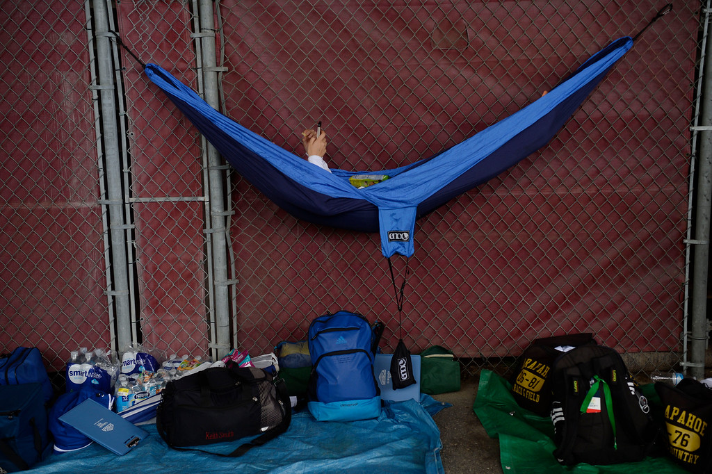 . Allison Marizza, Arapahoe, checks her phone messages while relaxing in a hammock under the stands of Jeffco Stadium while waiting for her 5A 4x400 race at the Colorado Track and Field State Championships May 21, 2016. (Photo by Andy Cross/The Denver Post)