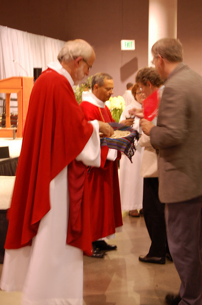 Presiding Bishop Mark S. Hanson distributing Holy Communion.