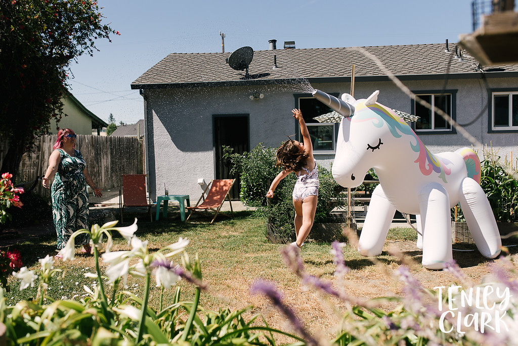 Giant unicorn sprinkler. Lifestyle in home family photography session in Fremont, CA by Tenley Clark Photography.