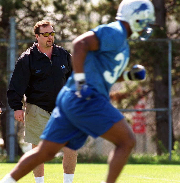 . Detroit Lions head coach Marty Mornhinweg, left, talks with team president and CEO Matt Millen, during the Lions morning session of mini camp, Friday, April 27, 2001, at the Lions practice facility in Pontiac, Mich.