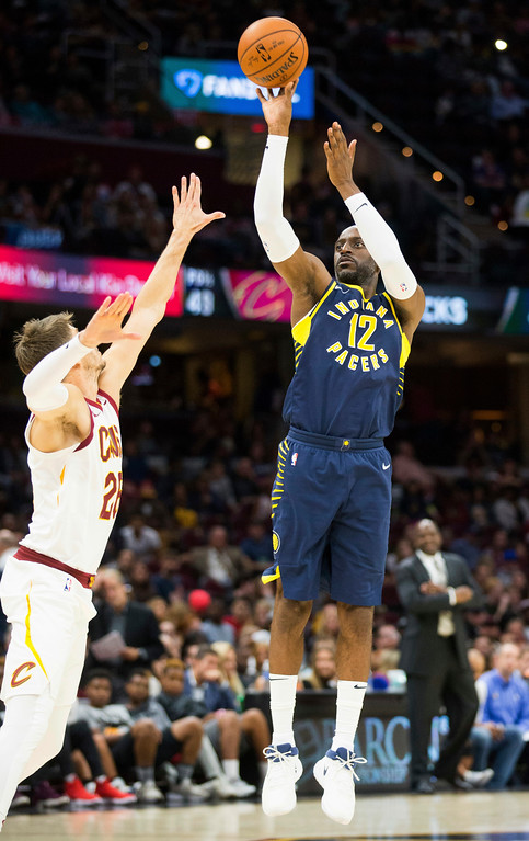 . Indiana Pacers\' Damien Wilkins (12) shoots over Cleveland Cavaliers\' Kyle Korver (26) during the fourth quarter of an NBA preseason basketball game, Friday, Oct. 6, 2017, in Cleveland. The Pacers won 106-102. (AP Photo/Scott R. Galvin)