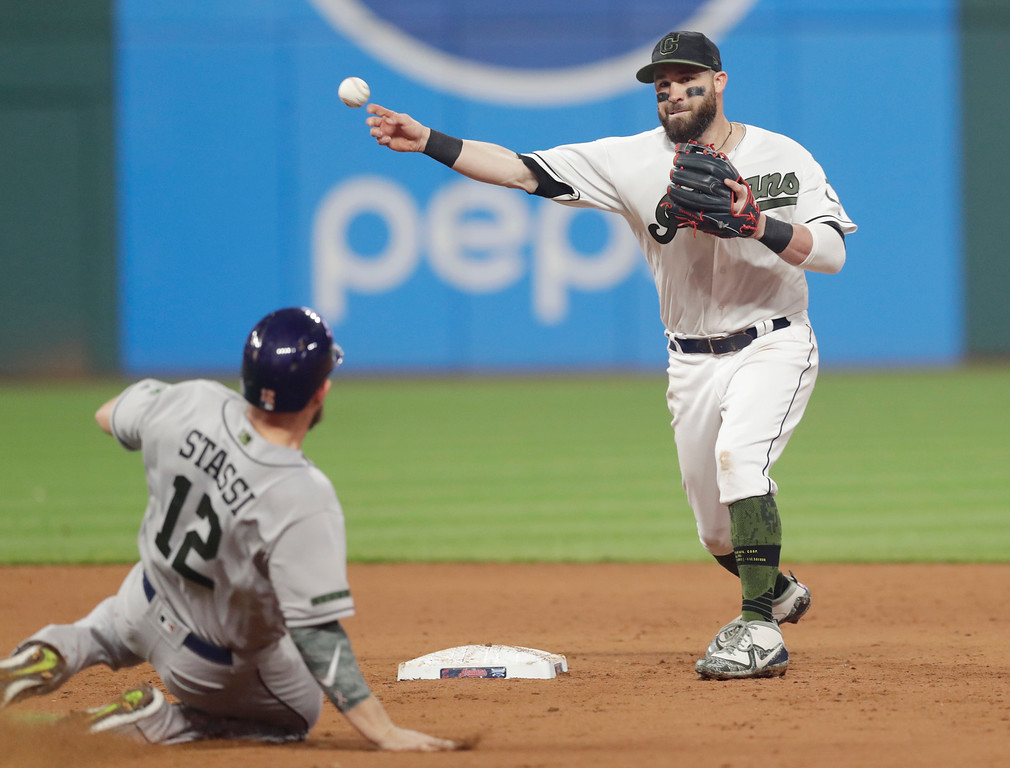 . Cleveland Indians\' Jason Kipnis throws to first base after getting Houston Astros\' Max Stassi out at second base in the eighth inning of a baseball game, Saturday, May 26, 2018, in Cleveland. Evan Gattis was out at first base for the double play. (AP Photo/Tony Dejak)