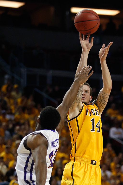. Josh Adams #14 of the Wyoming Cowboys takes a shot over Marvin Singleton #12 of the Northern Iowa Panthers during the second round of the 2015 Men\'s NCAA Basketball Tournament at KeyArena on March 20, 2015 in Seattle, Washington.  (Photo by Ezra Shaw/Getty Images)