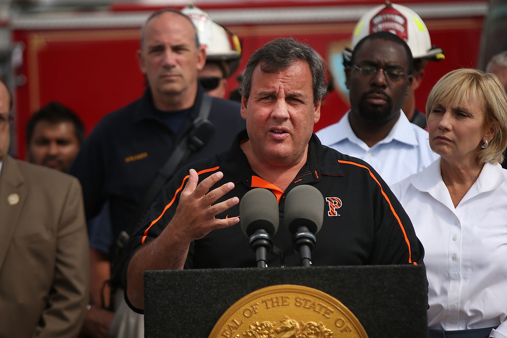 . New Jersey Gov. Chris Christie (C) speaks to the media at the scene of a massive fire that destroyed dozens of businesses along an iconic Jersey shore boardwalk on September 13, 2013 in Seaside Heights, New Jersey.  (Photo by Spencer Platt/Getty Images)