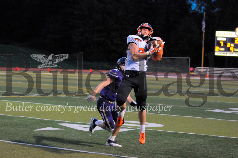 Clarion #22 Sam Minich leaps for a catch as Karns City #2 Anthony Kamenski goes in for the tackle during a game at Karns City Stadium on Friday September 7, 2018. (Jason Swanson photo)