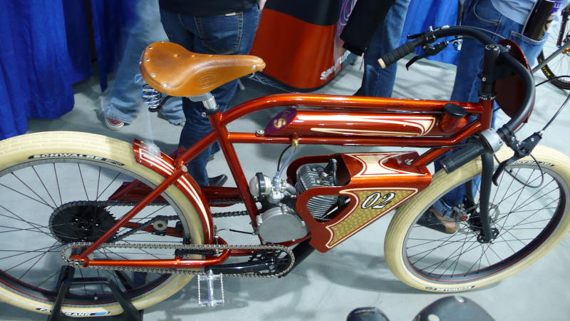 Hybrids, more or less - When you get tired of pedaling, this small gas engine can get you up the big hills.
