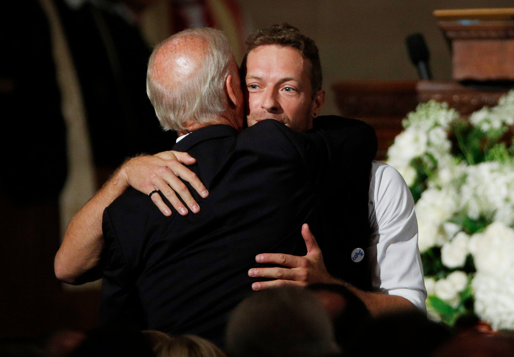 . Chris Martin of the band Coldplay hugs Vice President Biden after singing during funeral services for Biden\'s son, Beau,  Saturday, June 6, 2015, at St. Anthony of Padua Church in Wilmington, Del. Vice President Joe Biden\'s eldest son, died at the age of 46 after a battle with brain cancer.  (Kevin Lamarque/Pool Photo via AP)