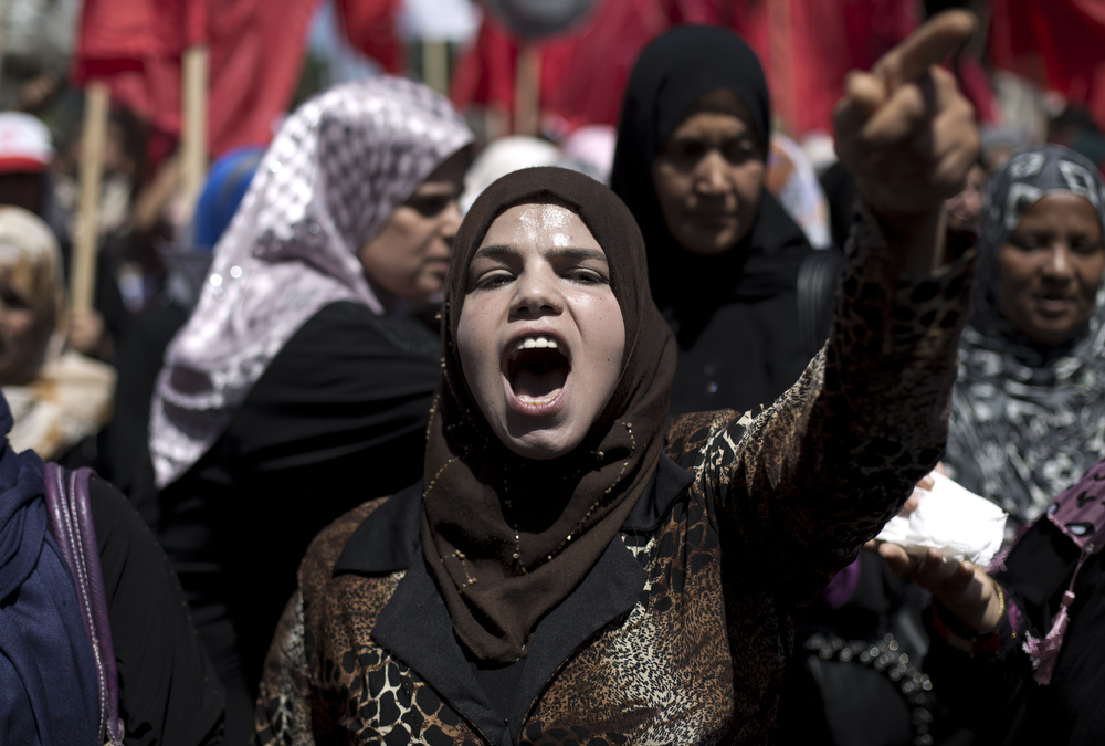 . A Palestinian woman chants slogans during a May Day rally, on May 1, 2014 in Gaza City. (MOHAMMED ABED/AFP/Getty Images)
