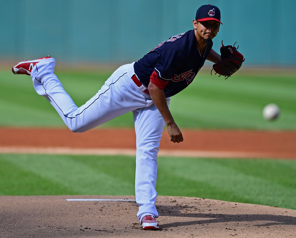 . Cleveland Indians starting pitcher Carlos Carrasco delivers in the first inning of a baseball game against the Tampa Bay Rays, Sunday, Sept. 2, 2018, in Cleveland. (AP Photo/David Dermer)