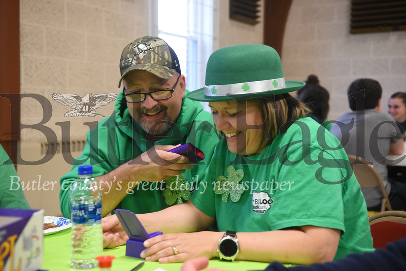 Christ Community United Methodist Church youth director Cherie and Kevin Loomis, of West Sunbury, play Taboo at St. Patrick Game Night on Sunday.