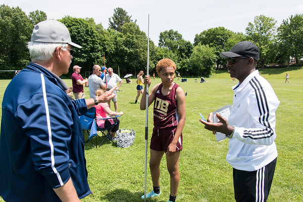 06/12/19 Wesley Bunnell | Staff Raven Jarrett became the first member of the New Britain High School girls track and field team to win the heptathlon with her performance on June 12, 2019 at Manchester High School. She held first place after day one on June 11, 2019 before slipping to second place on day two but would win the event with her finish in the 800 meter. Girls coach Darwin Shaw, R, speaks with Raven as boys coach Tim Kolodziej looks on.