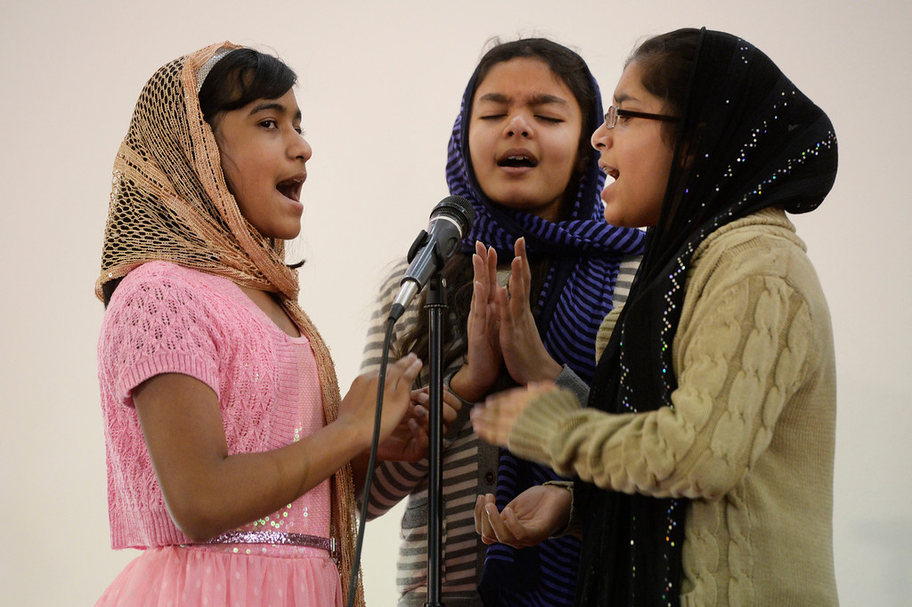 . AURORA, CO. - JANUARY 11:  Members of the Indian-Pakistan Bethel Pentecostal Worship team singers, left to right, Stefani Varghese, 11, Maya Sardar, 12, and Shifali Joseph, 12, perform at the Addis Kidan Evangelical Church for a dedication service, Saturday morning, January 10, 2014. (Photo By Andy Cross / The Denver Post)