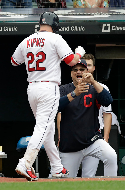 . Cleveland Indians manager Terry Francona, right, congratulates Jason Kipnis after Kipnis hit a three-run home run in the sixth inning of a baseball game against the Chicago White Sox, Wednesday, June 20, 2018, in Cleveland. (AP Photo/Tony Dejak)
