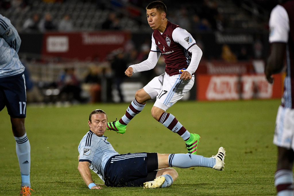 . COMMERCE CITY, CO - MAY 11: Dillon Serna (17) of Colorado Rapids watches his game-winning goal as Nuno Coelho (12) of Sporting Kansas City during the second half of the Rapids\' 1-0 win. The Colorado Rapids hosted Sporting Kansas City on Wednesday, May 11, 2016. (Photo by AAron Ontiveroz/The Denver Post)