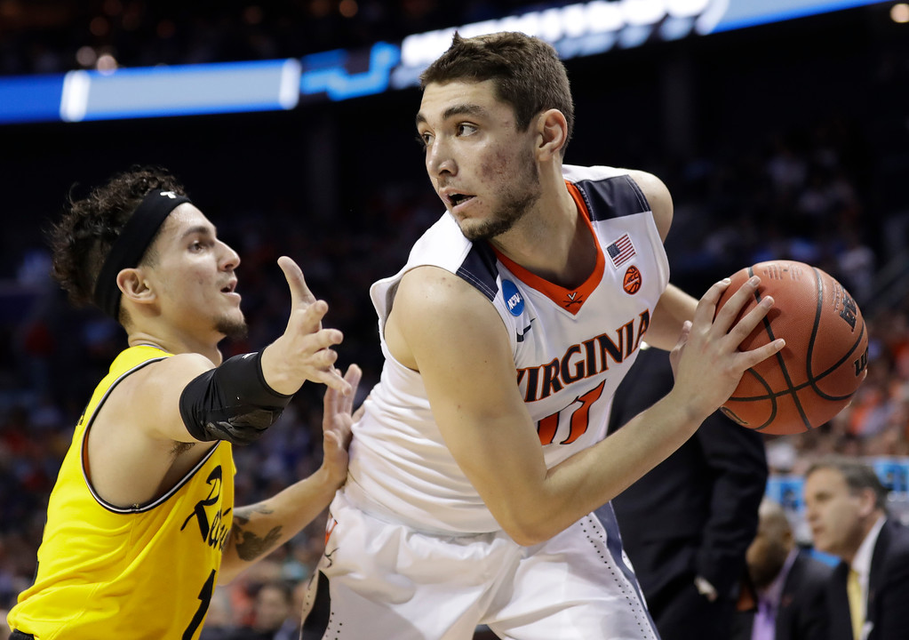 . Virginia\'s Ty Jerome, right, is guarded by UMBC\'s K.J. Maura during the first half of a first-round game in the NCAA men\'s college basketball tournament in Charlotte, N.C., Friday, March 16, 2018. (AP Photo/Gerry Broome)