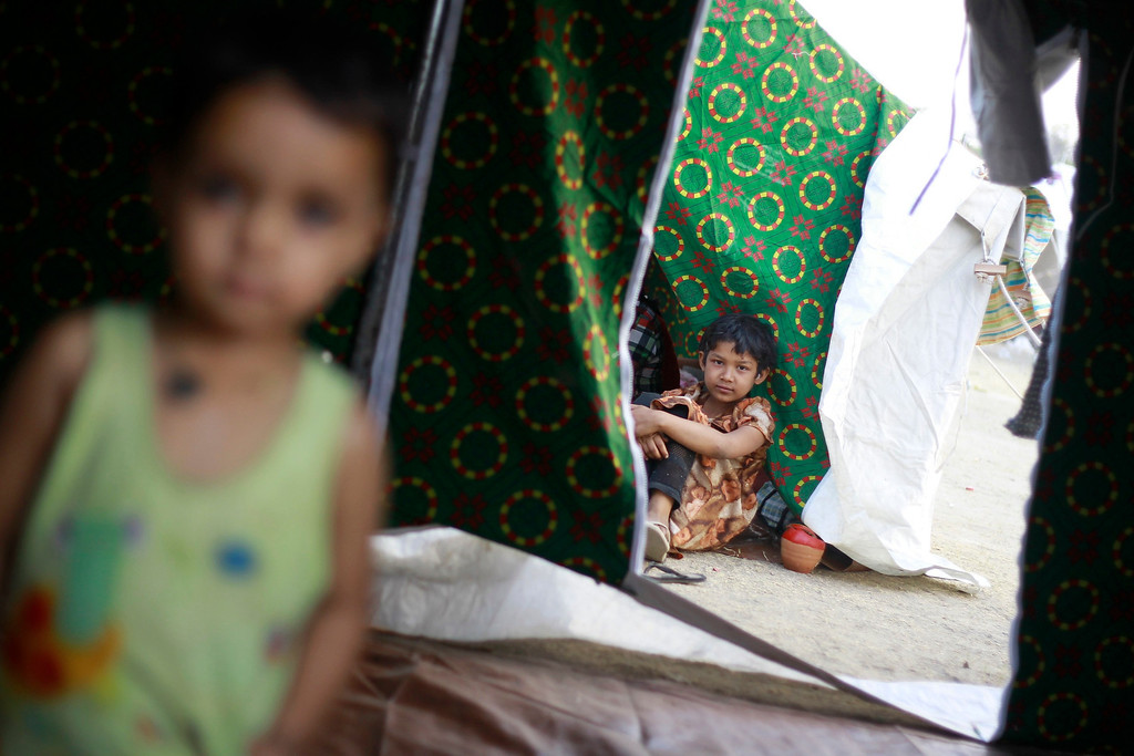 . Children sit in tents at a stadium amid riots in Meikhtila March 22, 2013.  REUTERS/Soe Zeya Tun