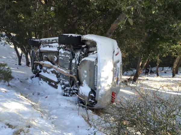 . A vehicle on its side on Wednesday, Dec. 31, 2014, after rolling off Highway 138 due to icy conditions from a cold winter storm that hit the region.(Photo by Sarah Alvarado/The Sun)