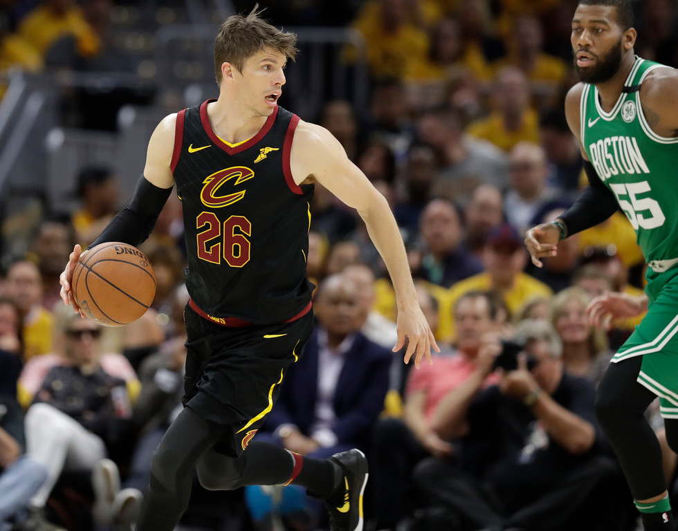. Cleveland Cavaliers\' Kyle Korver (26) looks past Boston Celtics\' Greg Monroe (55) in the second half of Game 3 of the NBA basketball Eastern Conference finals, Saturday, May 19, 2018, in Cleveland. The Cavaliers won 116-86. (AP Photo/Tony Dejak)