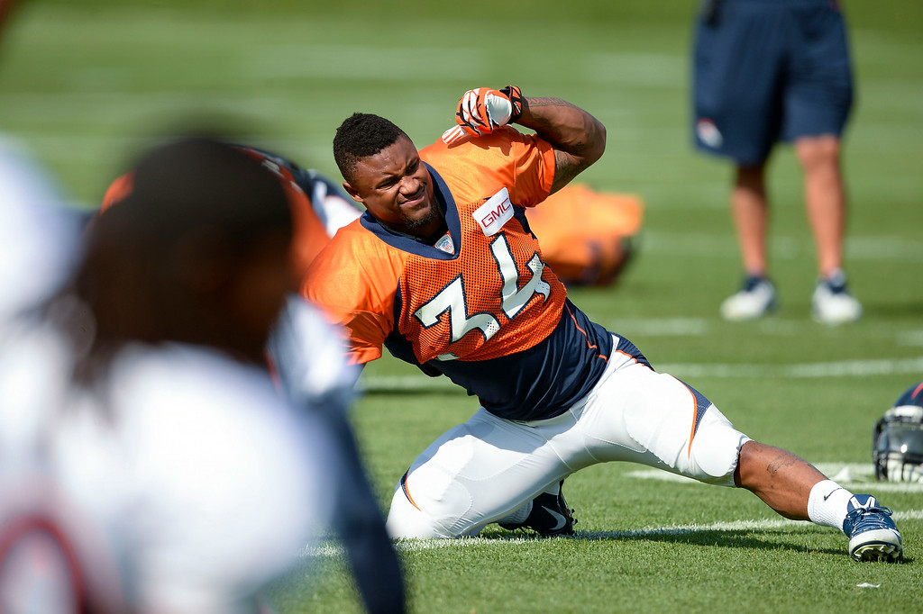 . Denver Broncos running back Brennan Clay (34) stretches on day five of the Denver Broncos 2014 training camp July 28, 2014 at Dove Valley. (Photo by John Leyba/The Denver Post)