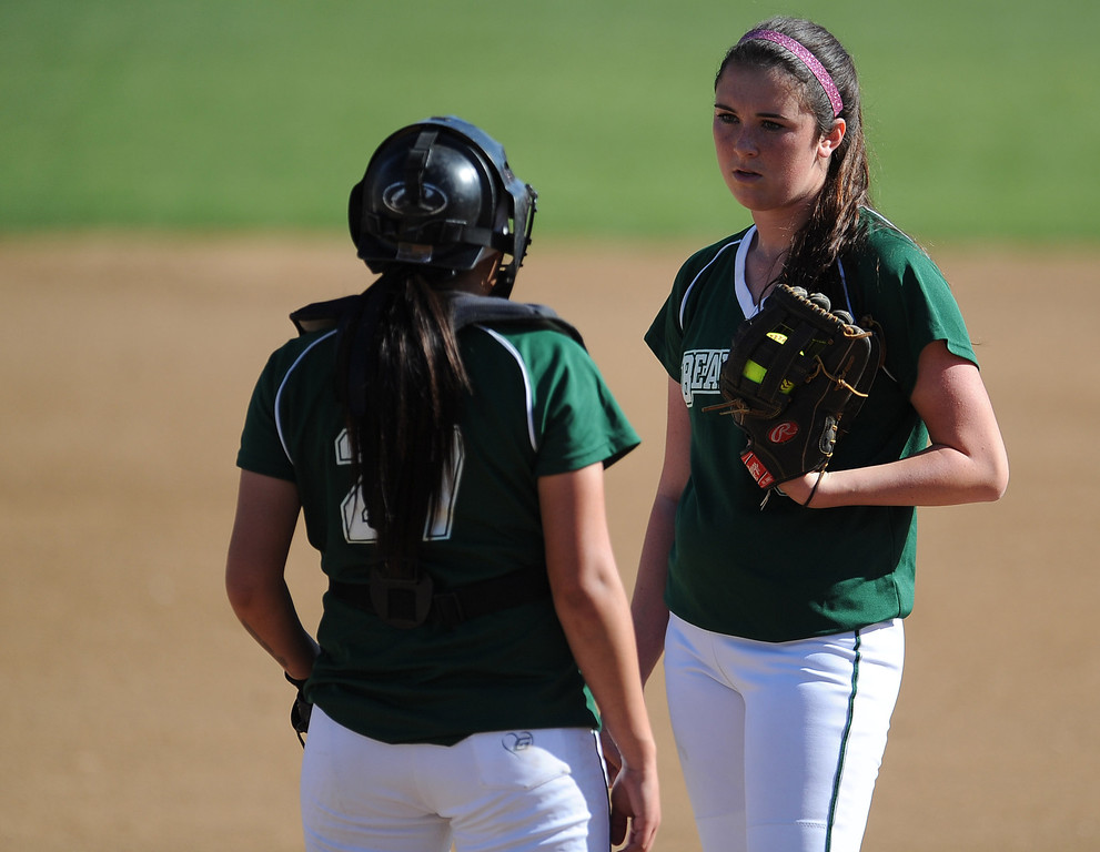. Bonita starting pitcher Bianca Cockrell talks with catcher Corrina Liscano (27) in the fifth inning of Charter Oak softball Tournament semifinal softball game against Corona Centennial at the Big League Field of Dreams Park on Friday, March 15, 2013 in West Covina, Calif. Corona Centennial won 5-1.  (Keith Birmingham Pasadena Star-News)