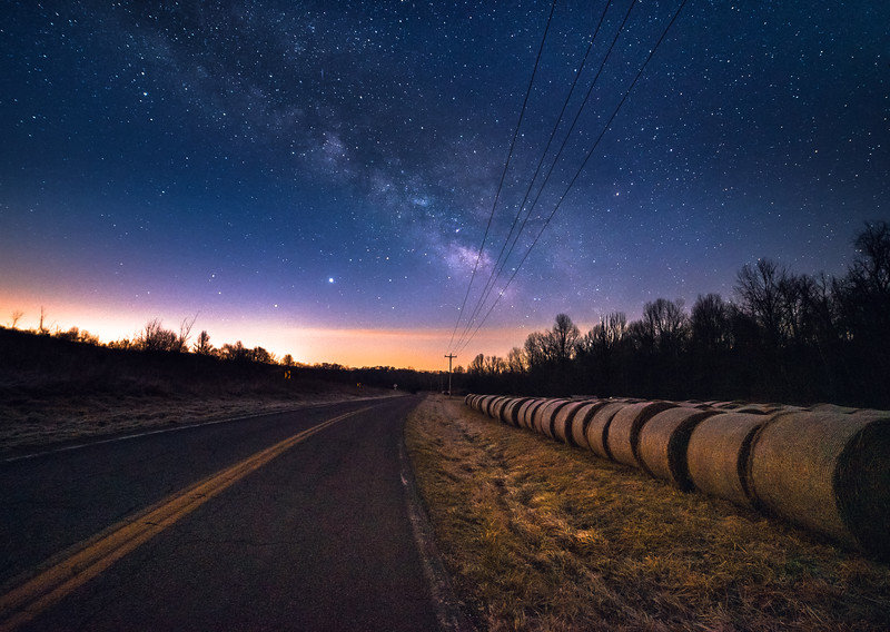 Round bales next to a county road under the stars #2