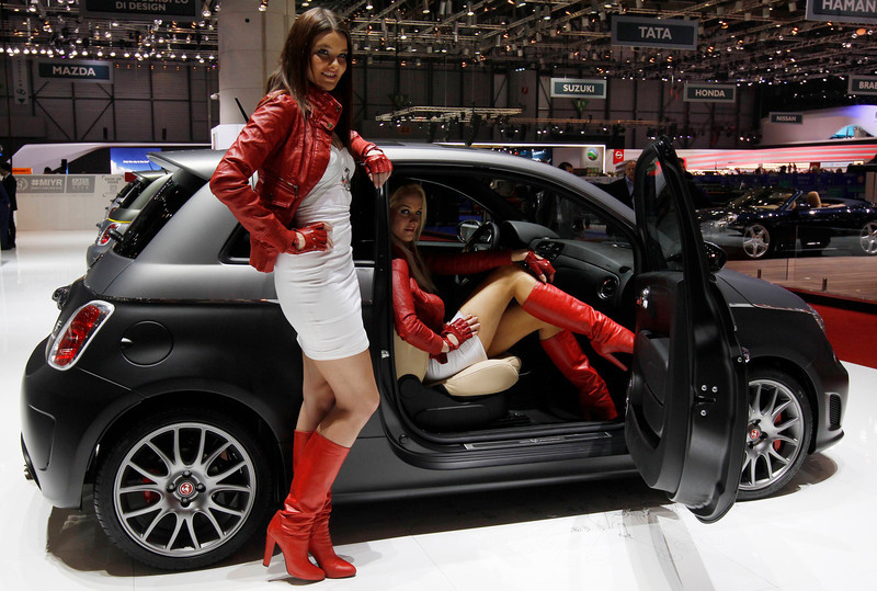 . Models present the Abarth 695 Black Diamond on the company\'s booth during the first media day of the Geneva Auto Show at the Palexpo in Geneva March 5, 2013. The Geneva Motor Show will take place from March 7 to 17, 2017. REUTERS/Denis Balibouse