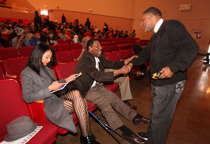 . Former A\'s pitcher, Michael Norris, middle, with Yuri Norris, left, greets Charles Franklin, right, before the start of Skyline\'s annual Black History Assembly at Skyline High School in Oakland, Calif. on Monday, Feb. 4, 2013. Mike Norris, former A\'s pitcher from 1975-83 and a member of the Black Aces, was honored at the assembly with a short video about his career and present work with inner city youth.  After Norris gave an inspirational talk to the Black Student Union about leadership, courage, and hard work, they voted to honor him at the assembly. He was presented with a plaque from the Oakland Unified School District and the Black Student Union at the assembly.   (Laura A. Oda/Staff)