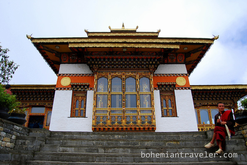 temple and monk at Dochula Pass Bhutan.jpg