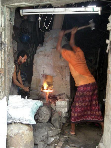 blacksmiths working in old souq in Taiz