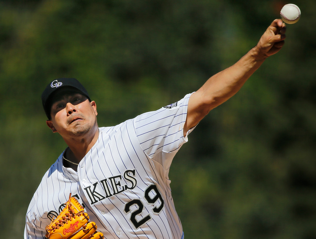 . Colorado Rockies starting pitcher Jorge De La Rosa throws to the pate against the Los Angeles Dodgers during the first inning of a baseball game Wednesday, Sept. 17, 2014, in Denver. (AP Photo/Jack Dempsey)