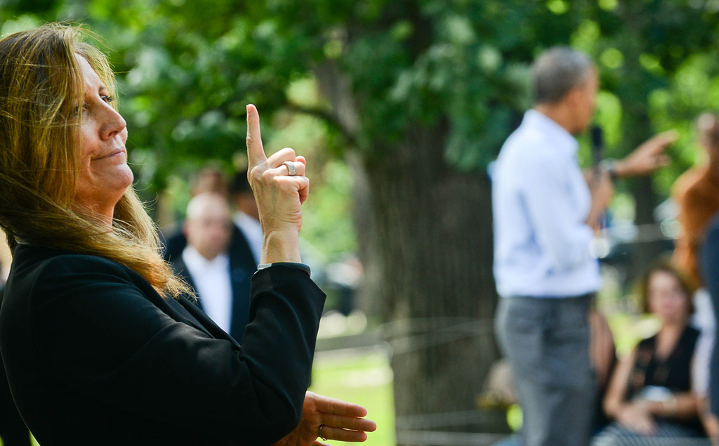 . A sign language interpreter works as President Barack Obama speaks at Minnehaha Park in Minneapolis on Thursday. (Pioneer Press: Ben Garvin)