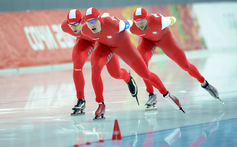 . (L-R) Poland\'s Zbigniew Brodka, Poland\'s Jan Szymanski and Poland\'s Konrad Niedzwiedzki compete in the Men\'s Speed Skating Team Pursuit Final B at the Adler Arena during the Sochi Winter Olympics on February 22, 2014. (JUNG YEON-JE/AFP/Getty Images)