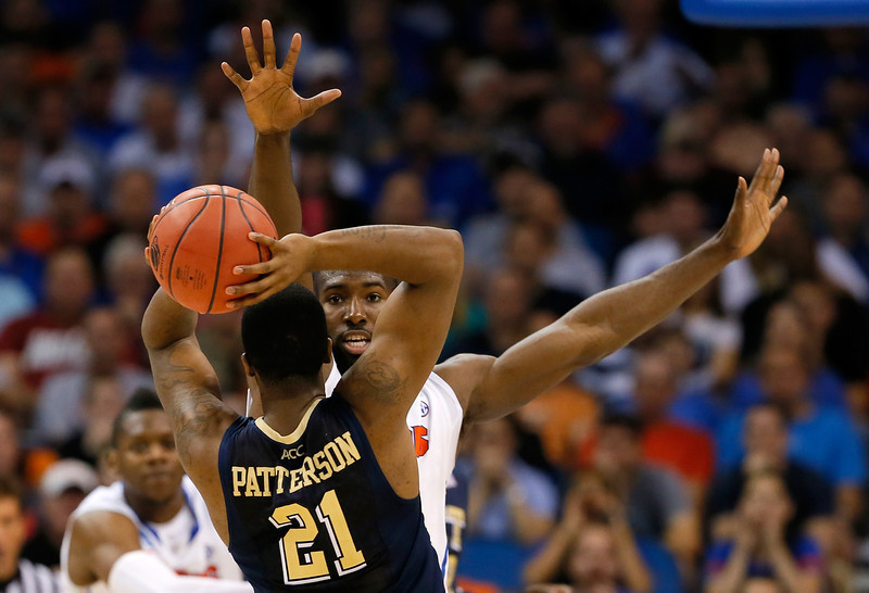 . Lamar Patterson #21 of the Pittsburgh Panthers looks to pass against Patric Young #4 of the Florida Gators in the second half during the third round of the 2014 NCAA Men\'s Basketball Tournament at Amway Center on March 22, 2014 in Orlando, Florida.  (Photo by Kevin C. Cox/Getty Images)