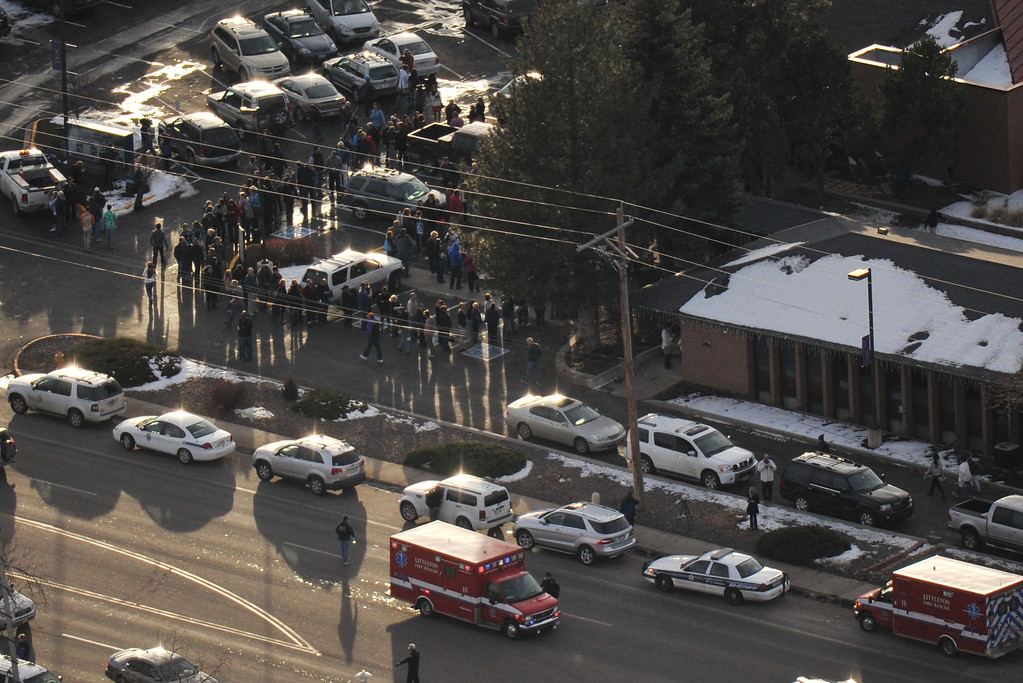 . Centennial, CO. DECEMBER 13: People line out side of Shepherd of the Hills Lutheran Church school, one of the reunification centers, with their families following a shooting incident at Arapahoe High SchoolArapahoe High School in Centennial, Colorado,  December 13, 2013. (Photo by Hyoung Chang/The Denver Post)